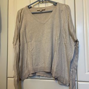 Loose-fitting tan sweater.